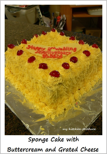 Sponge Cake with Buttercream and Grated Cheese